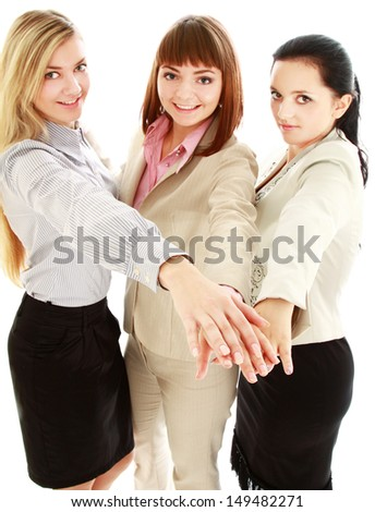 businesswomen putting their hands, isolated on white background - stock photo