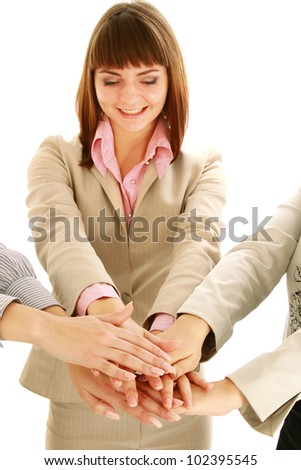 Businesswomen putting their hands together, isolated on white - stock photo