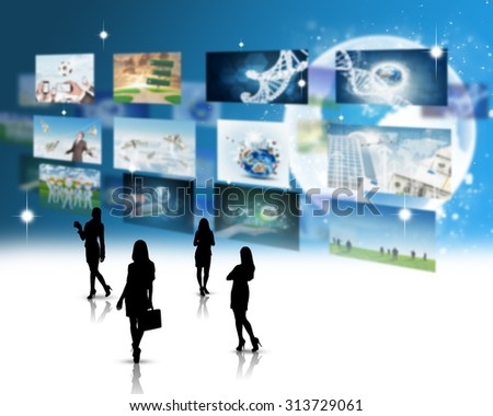 Businesswomen silhouettes with holographic screens background and pictures