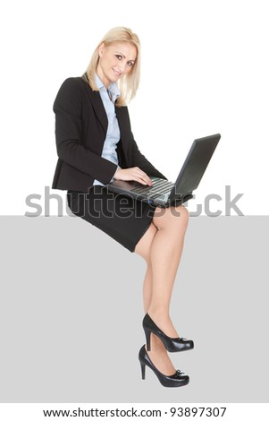 Businesswomen sitting on copyspace. Isolated on white - stock photo