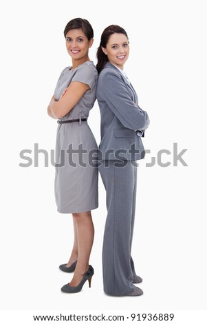Businesswomen standing back on back against a white background - stock photo