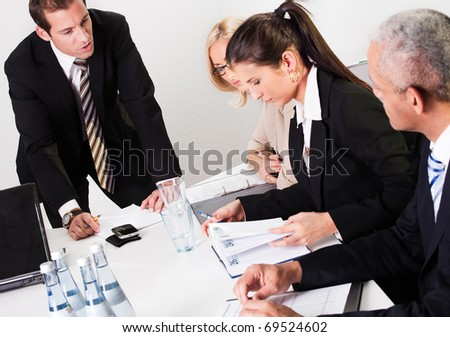 Businesswomen taking notes at the presentation - stock photo