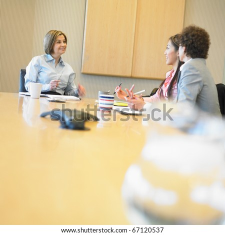 Businesswomen talking in conference room - stock photo
