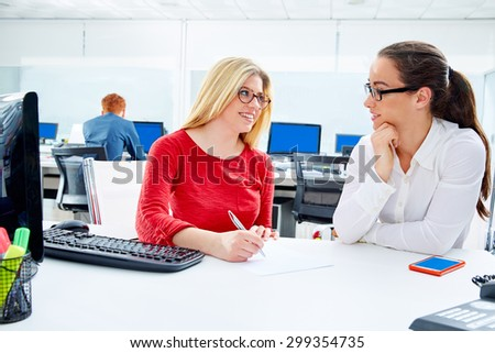 Businesswomen team working at offcce desk with computer teamwork - stock photo