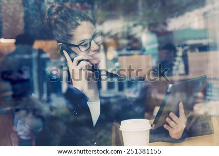 Businesswomen using a mobile phone - stock photo
