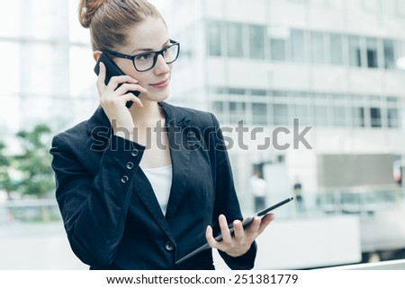Businesswomen using a mobile phone