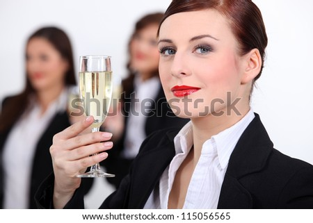 Businesswomen with champagne - stock photo