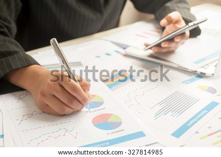 Businesswomman examine finance, tax, accounting, statistics and analytic research concept - stock photo