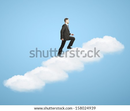 businnessman walking up stairs out of clouds