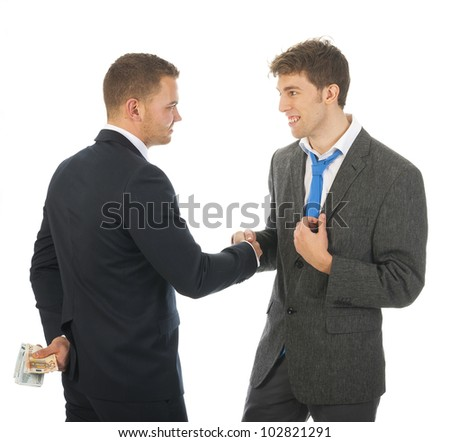 Businnessmen with money behind his back, shake hands - stock photo