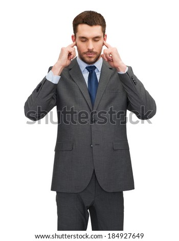 businss, office and education concept - annoyed businessman covering his ears with his hands - stock photo