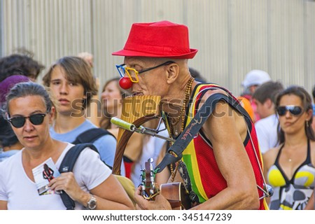 Busker musician on the streets of Barcelona. Spain, Barcelona , August 9 , 2012 - stock photo