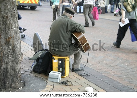Busker with Electric Guitar on Liverpool City Centre Street