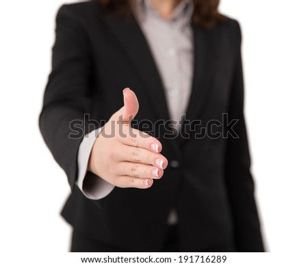 Busnesswoman going to shake your hand. Shallow depth of field, focus on fingers.