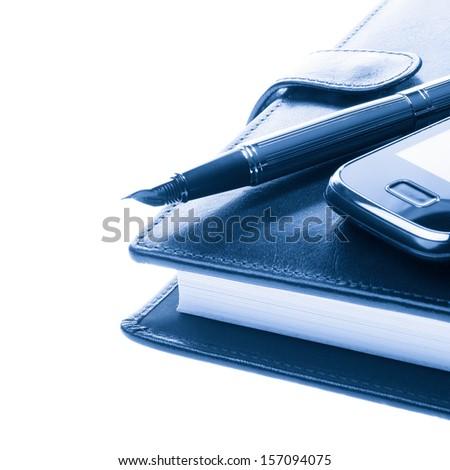 Bussines concept, callendar book, pen and mobile phone - stock photo