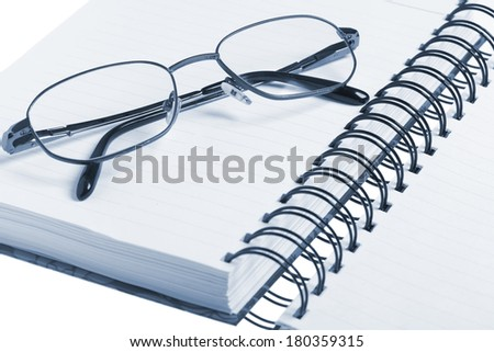 Bussines concept, notebook and glasses - stock photo