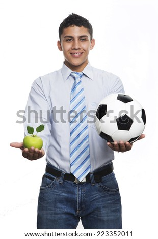 Bussines young man with black and white soccer ball and green apple isolated in white background  - stock photo
