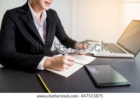 Bussiness concept, Bussiness woman working with bill on wooden table