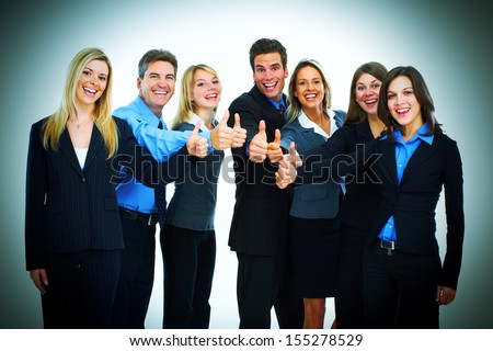 Bussiness team of men and women thumbs up - stock photo