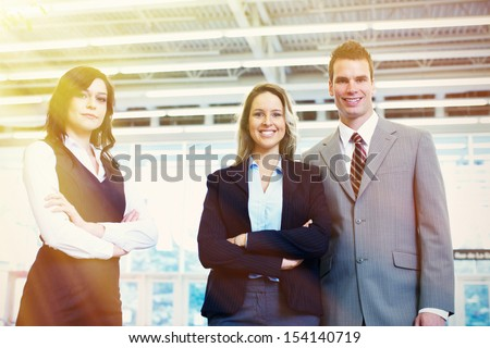 Bussiness team of three persons in office - stock photo