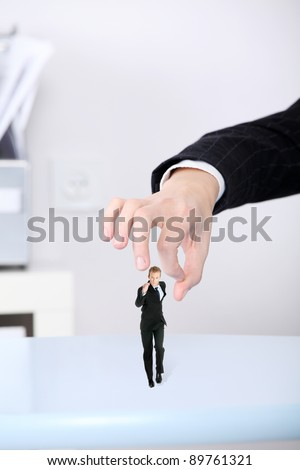 Bussineswoman getting rid of her employee. - stock photo