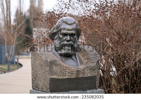 bust of Karl Marx in the park is photographed close-up