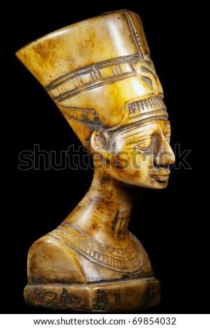 bust of Queen Nefertiti on black background - stock photo