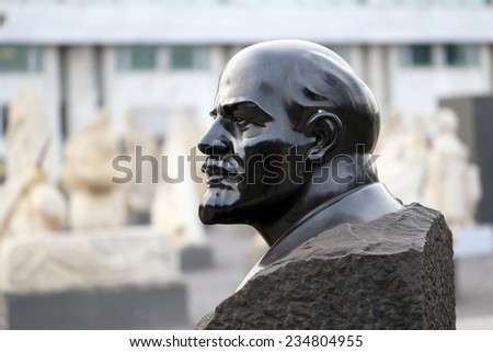 bust of Vladimir Lenin in the park is photographed close-up - stock photo