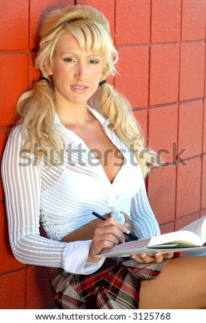 Busty student with book - stock photo
