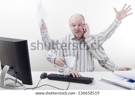 Busy and multitasking office worker with arms all over in the office. To much work. - stock photo