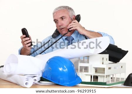 Busy architect - stock photo