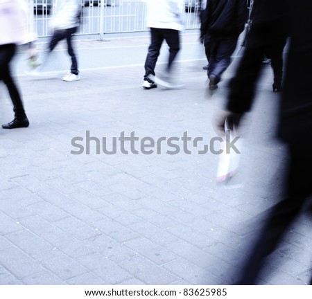 Busy big city people walk on street at blur motion - stock photo