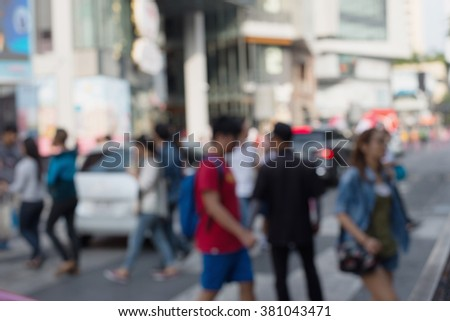 Busy big city street people on zebra crossing - stock photo