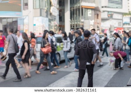 Busy big city street people on zebra crossing