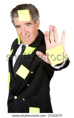 busy business man over a white background with a post it on his hand which is where the focus is so you can write something on it - stock photo