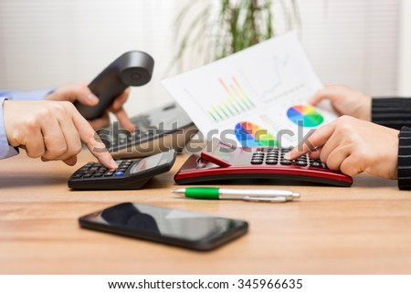 busy business team are working on financial report and calling client - stock photo