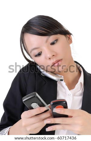 Busy business woman phoning someone and reading SMS against white. - stock photo