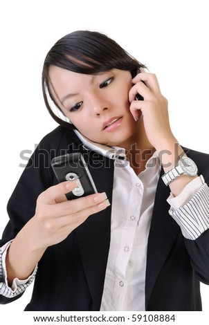 Busy business woman using cellphone and reading SMS, closeup portrait on white background. - stock photo