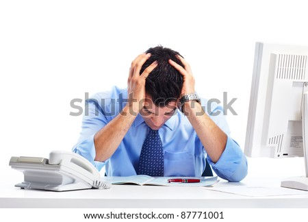 Busy businessman having stress and headache at office. - stock photo