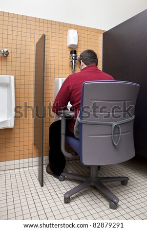 Busy businessman multitasking - stock photo