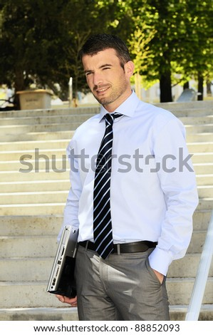 busy businessman outdoor with his computer - stock photo