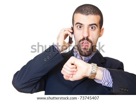 Busy Businessman Talking on Mobile While Looking at Time - stock photo