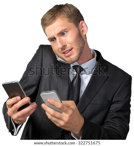 Busy businessman talking the phone - stock photo