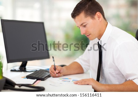 busy businessman working in office - stock photo