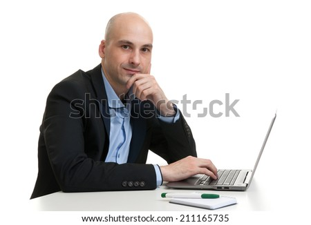 Busy businessman working on his laptop - isolated on white