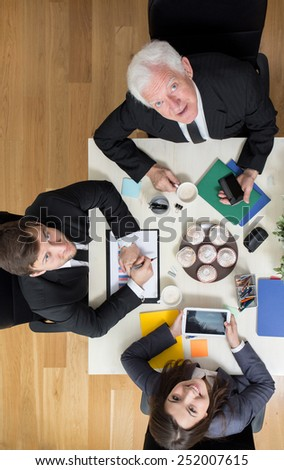Busy businesspeople during assemblage in company - stock photo