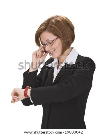 Busy businesswoman checking the time while calling.