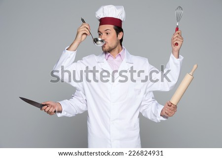 Busy chef concept with many hands isolated on white background. guy with four arms holding kitchen tools and tasting food - stock photo