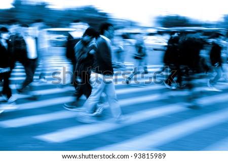 busy city people crowd on zebra crossing street - stock photo