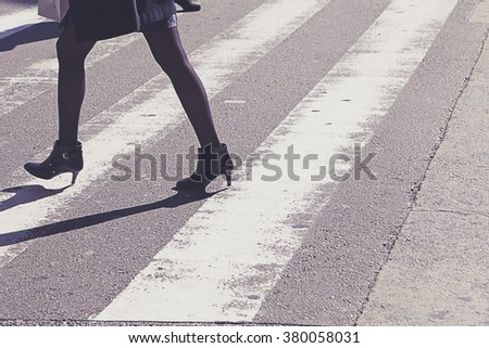 Busy city people on zebra crossing street - stock photo